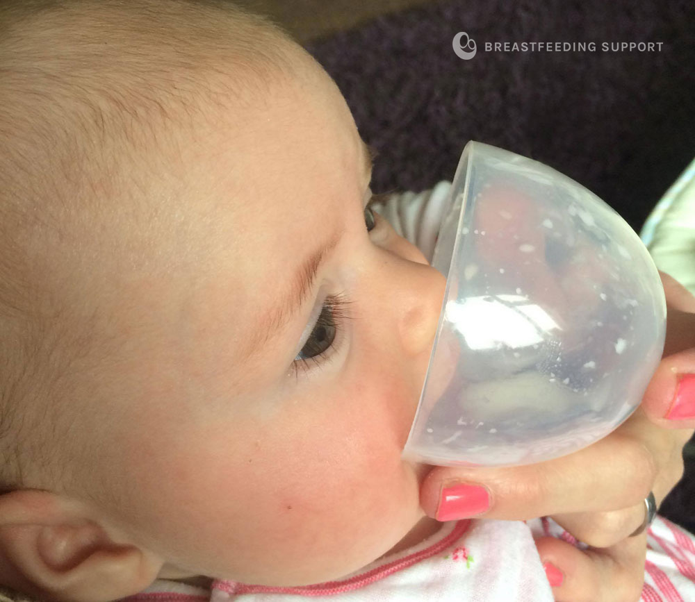 baby drinking from an open cup